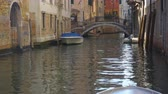 Венеция : Perspective of canal with bridge and moored boats in Venice, Italy Стоковые видеозаписи