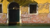 Entry of old house by canal in Venice and moving sun reflections on the wall, Italy Dostupné videozáznamy