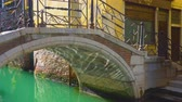 Small bridge over canal in Venice with moving sun reflections, Italy Dostupné videozáznamy