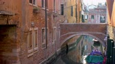 Perspective of canal with bridge and moored boats in Venice, Italy Dostupné videozáznamy