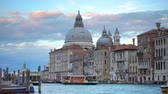 Мария : Venice, Italy - June 14, 2018: Traffic on The Grand Canal near Santa Maria della Salute church in Venice in the evening