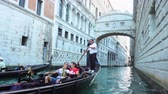 oblouk : Venice, Italy - June 17, 2018: Gondolas with tourists near The Bridge of Sighs (Ponte dei Sospiri) in Venice