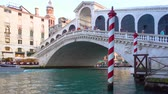 benátky : Venice, Italy - June 17, 2018: Water taxi goes under The Rialto Bridge in Venice Dostupné videozáznamy