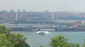 The Galata Bridge and The Golden Horn Metro Bridge in Istanbul and tourist ship, Turkey