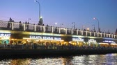вывеска : Istanbul, Turkey - July 15, 2018: Cafes and restaurant with turkish fish sandwiches (Balik Ekmek) on The Galata Bridge in Istanbul at night