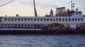 vessel traffic : Istanbul, Turkey - July 15, 2018: Tourist pleasure ship goes near the Galata Bridge in Istanbul in the evening