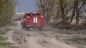 field : Firefighters drove up to the site of fire Stock Footage