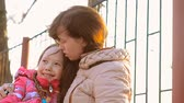 coat : Woman with daughter hugging Stock Footage