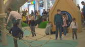 escada : Moscow, Russia - September 16, 2018: Kids plaing in the play area of the shopping center under parental control. Playful Children frolic in the gaming zone of the shopping center under the supervision of parents.