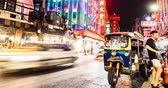 hirdetés : Bangkok, Thailand - May 8, 2019: 4k timelapse with high frame rate The movement of cars andp people in the night asian city. Lights of a big city. Chinatown is the big market shopping and foods street. Street Food Shopping Area, Yaowarat Road. Night life