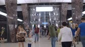 descendre : Moscow, Russia - September 11, 2019: People go up and go down to the underground subway. Modern metro station and hurrying people of the big city. Contemporary subway station. The movement of diversity people in the subway. Vidéos Libres De Droits