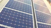 solar energy power : Large solar panels on factory roof at sunrise. Aerial shot Stock Footage