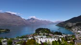 background : Queenstown, New Zealand, medium shot of the harbour.