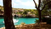 Yachting on sunny Cala Sa Nau, Mallorca, Spain