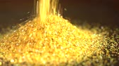 эмаль : Fallen golden glitter dust. Gold sparkles fall to a pile