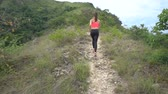 namorado : Young sporty boy and girl jogging on mountain track. Woman and man work out in nature. Slow motion
