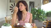 Girl eat cake and drink coffee