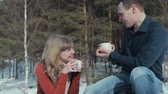 tart : Young couple in love on a winter vacation enjoying the nature and drinking hot tea, HD