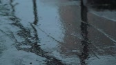drench : Big large drops of rain fall crashing to the ground. With lots of splashes