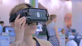 head mounted display : MOSCOW, RUSSIA - SEPTEMBER 8, 2017: City of Education Exhibition. Young woman using virtual reality glasses. VR