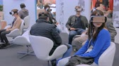 head mounted display : MOSCOW, RUSSIA - JULY 12, 2017: Moscow Urban Forum. Group of people using virtual reality headset at exhibition, show. VR cinema concept