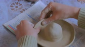 crafting : Woman potter making clay lemon squeezer in pottery workshop, studio. Handmade, art and handicraft concept