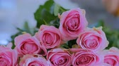 arranjando : Professional floral artist, florist working with flowers - pink roses at workshop, flower shop. Floristry, handmade and small business concept