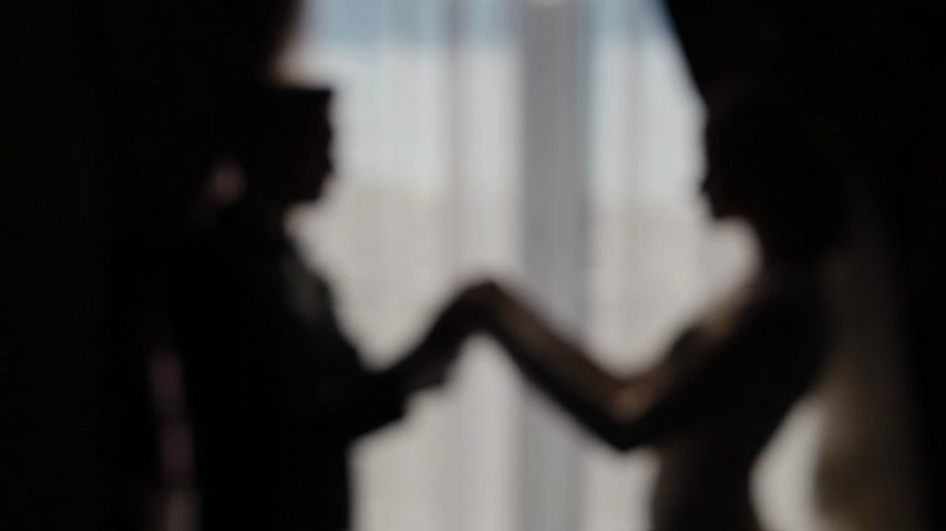 koca : Bride, groom holding hands in front of the window