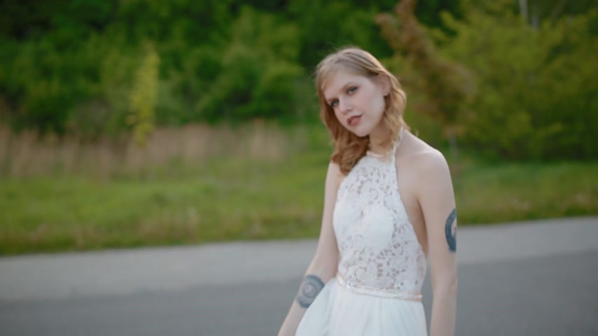 high spirited : Young caucasian couple posing outdoor. Biker wedding style.