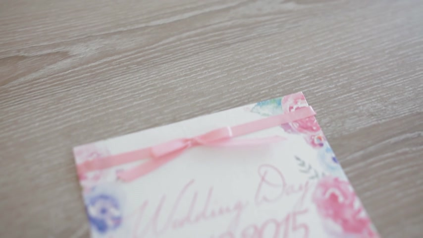 zaproszenie : Beautiful wedding invitation watercolor card on the chair Wideo