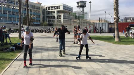 quads : BARCELONA, SPAIN - MAY 2017: People studing how to ride quads on Barceloneta district. Spring time