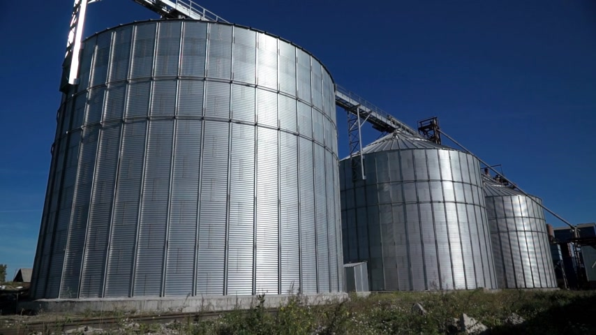 Big group of grain dryers complex for drying wheat. Modern grain silo Dostupné videozáznamy
