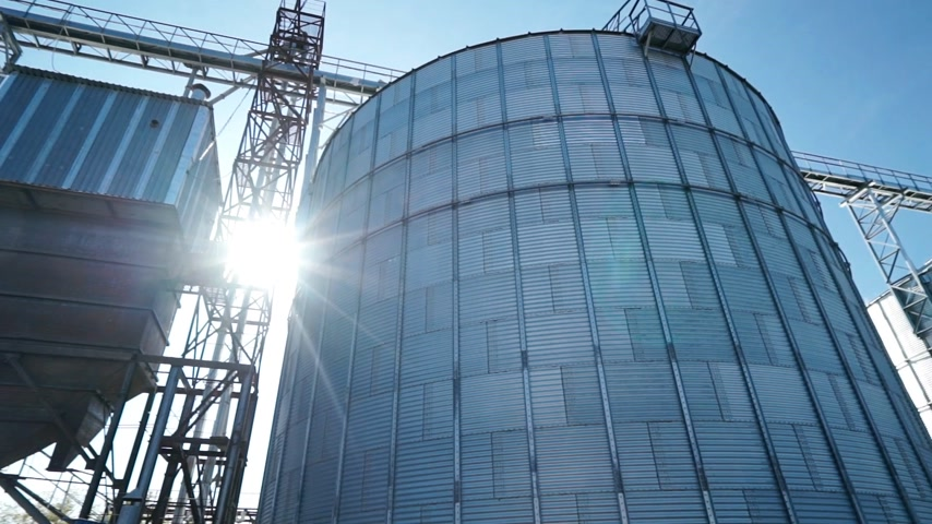 overview of big group of modern grain dryers (silo) complex for drying wheat