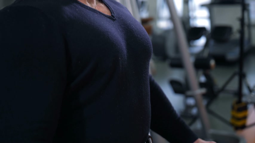 straining : Adult bodybuilder straining chest muscles and smiling 4K Slow Mo