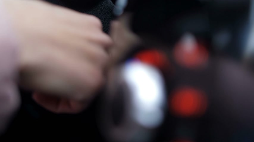tutuşturmak : Close-up. Female hand pulls keys out of ignition, panel buttons turn off 4K Slow Mo Stok Video