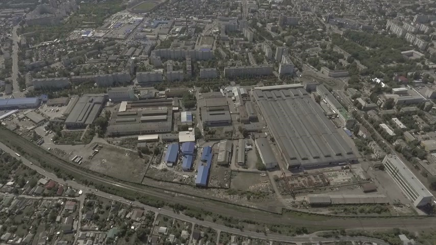 soviético : Drone. View from above. In the middle of the city is an old factory.