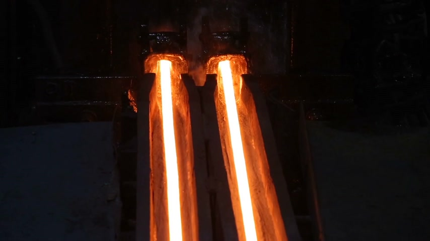 blast furnace : Very beautiful video from the metallurgy plant. Red-Hot finished products move black machines.