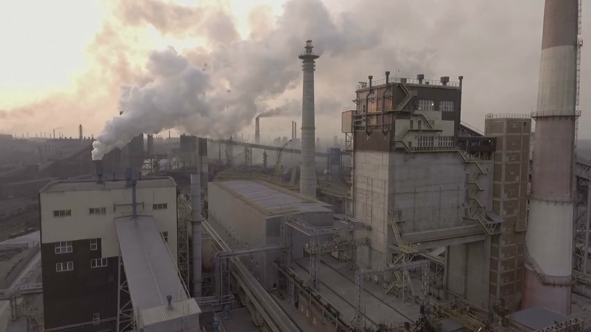 metallurgical plant : Drone. Flying over the metallurgical plant. A huge area of pipes comes out a lot of dirty smoke.