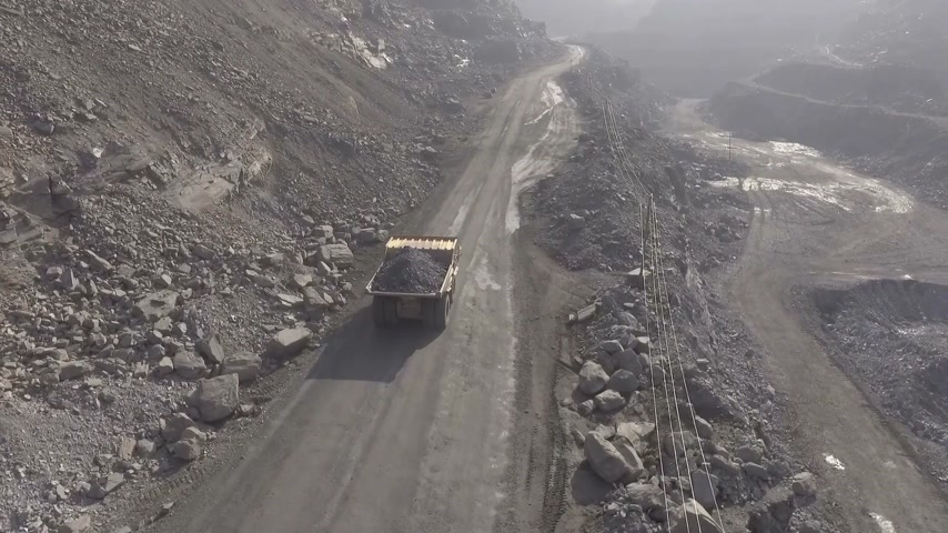 opencast : Shooting from the air. In a quarry, a BelAZ rides full of iron ore. Stock Footage