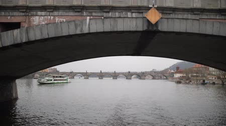 wandering : River in Prague. Swim under the bridge on the water. 4K Slow Mo Stock Footage