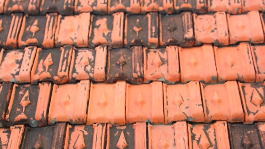covering : Red rooftop baked clay tiles old and weathered panning camera high definition stock footage clip. Stock Footage