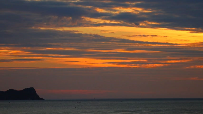 keleti : South china sea tropical sunrise orange sky scene with fishing boats, ocean waves, orange red cloudscape sky, central Vietnam. Panning panoramic scenery.