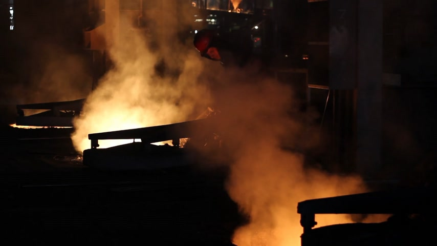 ferro : Hard work in the foundry, worker controlling iron smelting in furnaces