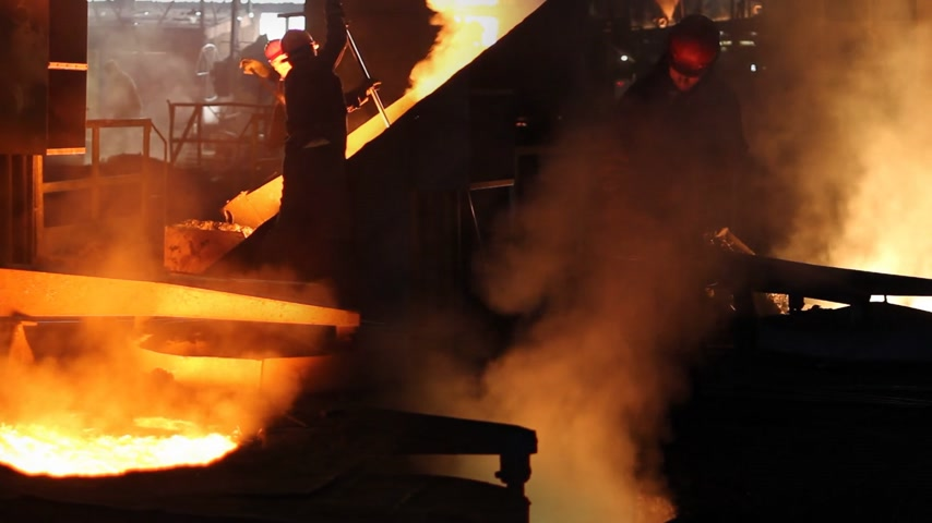 ferro : Hard work in the foundry, worker controlling iron smelting in furnaces, too hot and smoky working environment