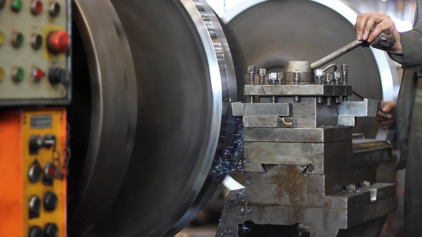 production tool : Machining process, close up, metalworking on a lathe in factory
