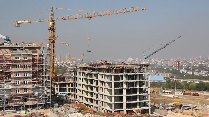 kentsel : Construction site and a lot of cranes. Building of apartments