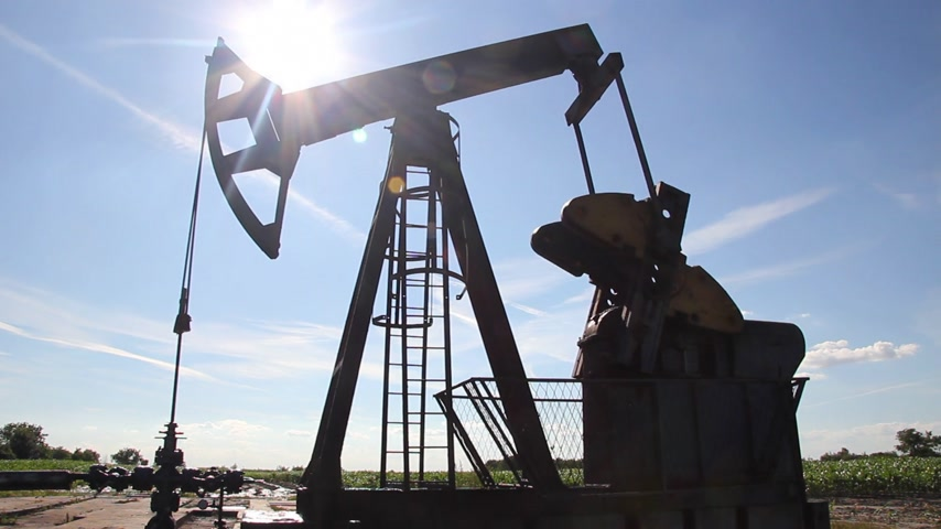 conventional : Oil Pump Jack in a Field