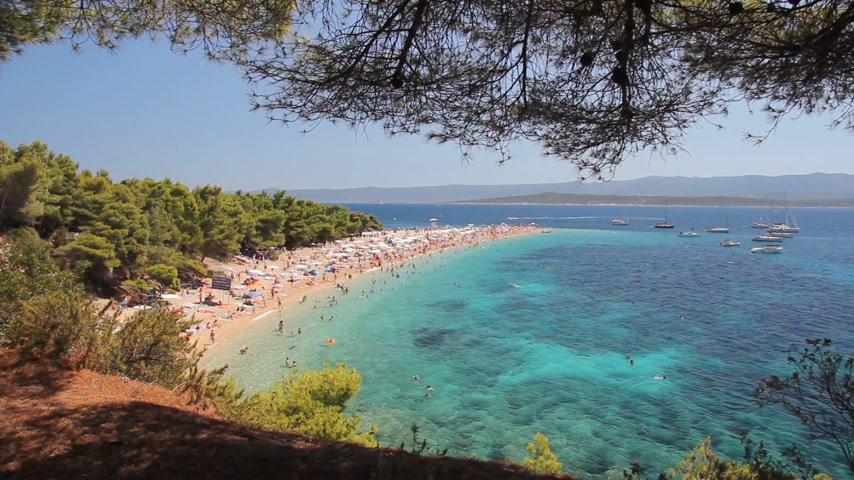 vacation destination : Summertime at Adriatic Sea. Famous beach in Bol on Island Brac in Croatia Stock Footage