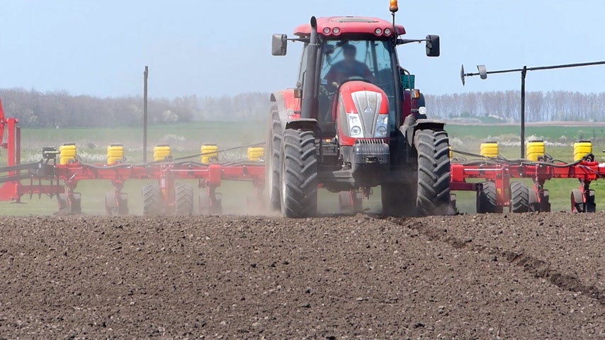 farm equipment : Tractor and Seeder Planting Crops