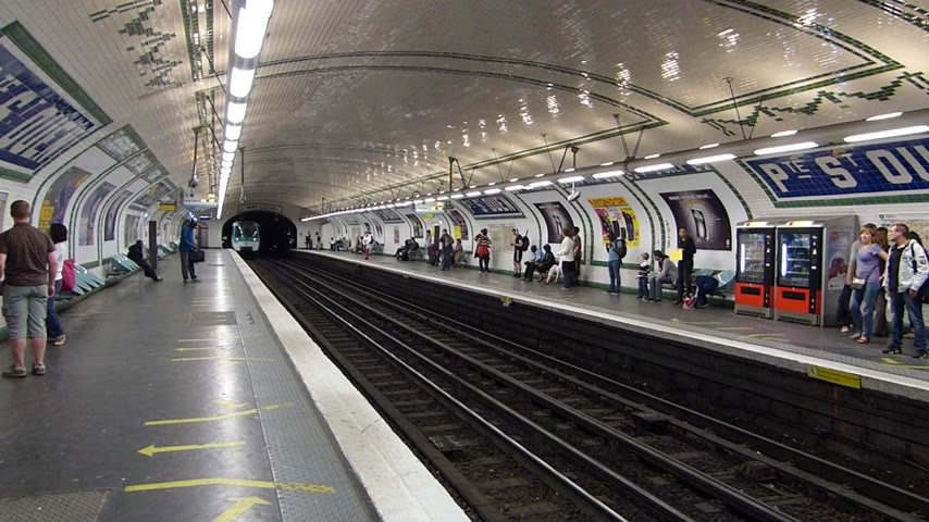 french metro : Metro in Paris, France. People wait and travel by train in subway. Stock Footage